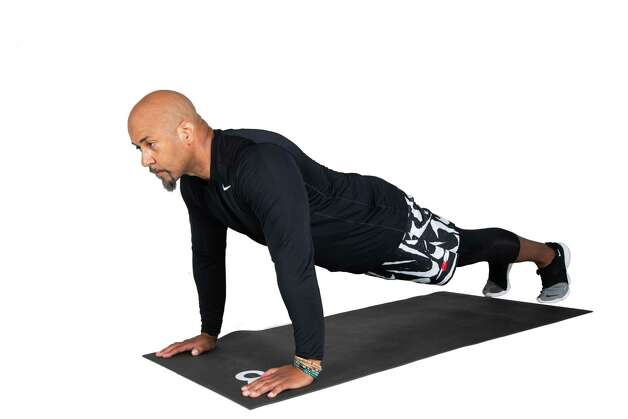 Start in a pushup-plank position with hands placed under shoulders. Photo: Marie D. De Jesús, Houston Chronicle / Staff Photographer / © 2021 Houston Chronicle