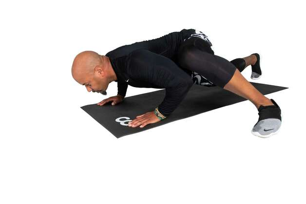 Explode forward while swinging the left leg into a lunge position. Maintain a neutral spine and lower down into a pushup position. Return to start position and repeat on the opposite leg. Photo: Marie D. De Jesús, Houston Chronicle / Staff Photographer / © 2021 Houston Chronicle