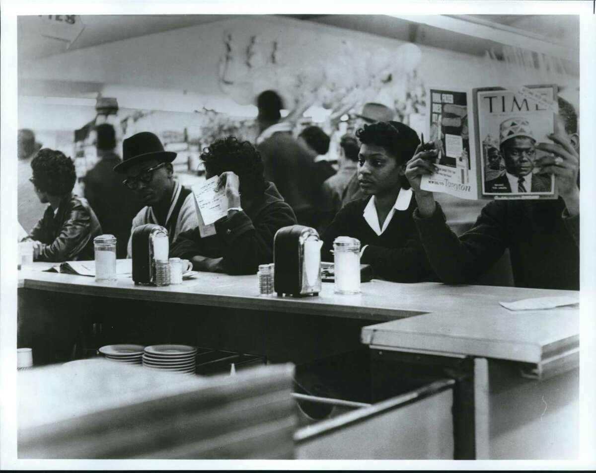 Students sit in to desegregate a Weingarten's lunch counter in Houston.