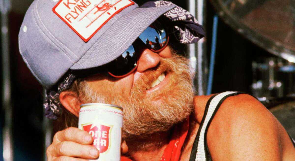 Willie Nelson with a can of Lone Star. In the 1970s, the country legend was instrumental in boosting the brand in exchange for free beer.