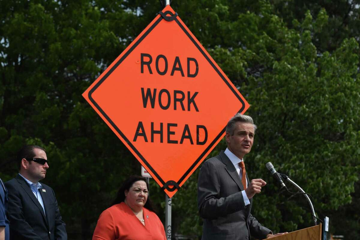 Brian Turmail, spokesman for the Associated General Contractors of America, joins state transportation and construction association officials in urging drivers to pay attention in highway construction zones as motorists take to the roads for the summer travel season on Wednesday, May 26, 2021, at the I-87 rest area in Clifton Park, N.Y. He is joined by Mike Elmendorf, president and CEO of the AGC of New York, left, and Transportation Commissioner Marie Therese Dominguez, center. Two work zone intrusions resulting in worker hospitalizations occurred in the Capital Region within the last 3 weeks. (Will Waldron/Times Union)