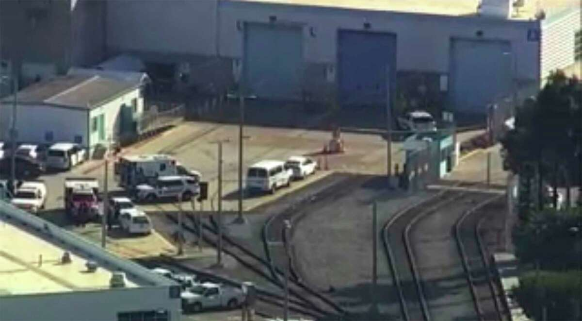 In this photo provided by KGO-TV/ABC7, emergency personnel respond to the scene of a shooting on Wednesday, May 26, 2021, in San Jose, Calif. A Santa Clara County sheriff's spokesman said there are multiple fatalities and injuries in a shooting at a rail yard and that the suspect is dead.