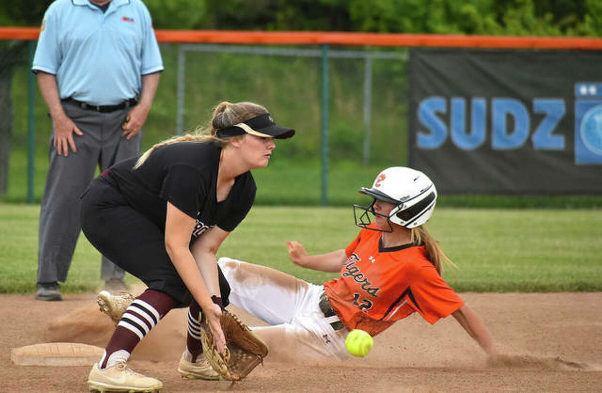 Edwardsville's Maci McNamee slides safely into second base with a stolen base during Tuesday's game against Belleville West.