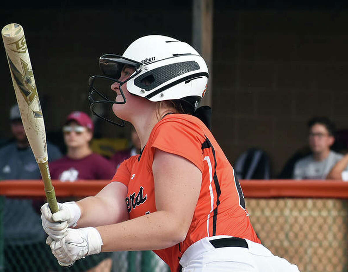 Edwardsville's Lexie Griffin watches her RBI single up the middle in the first inning on Tuesday against Belleville West.