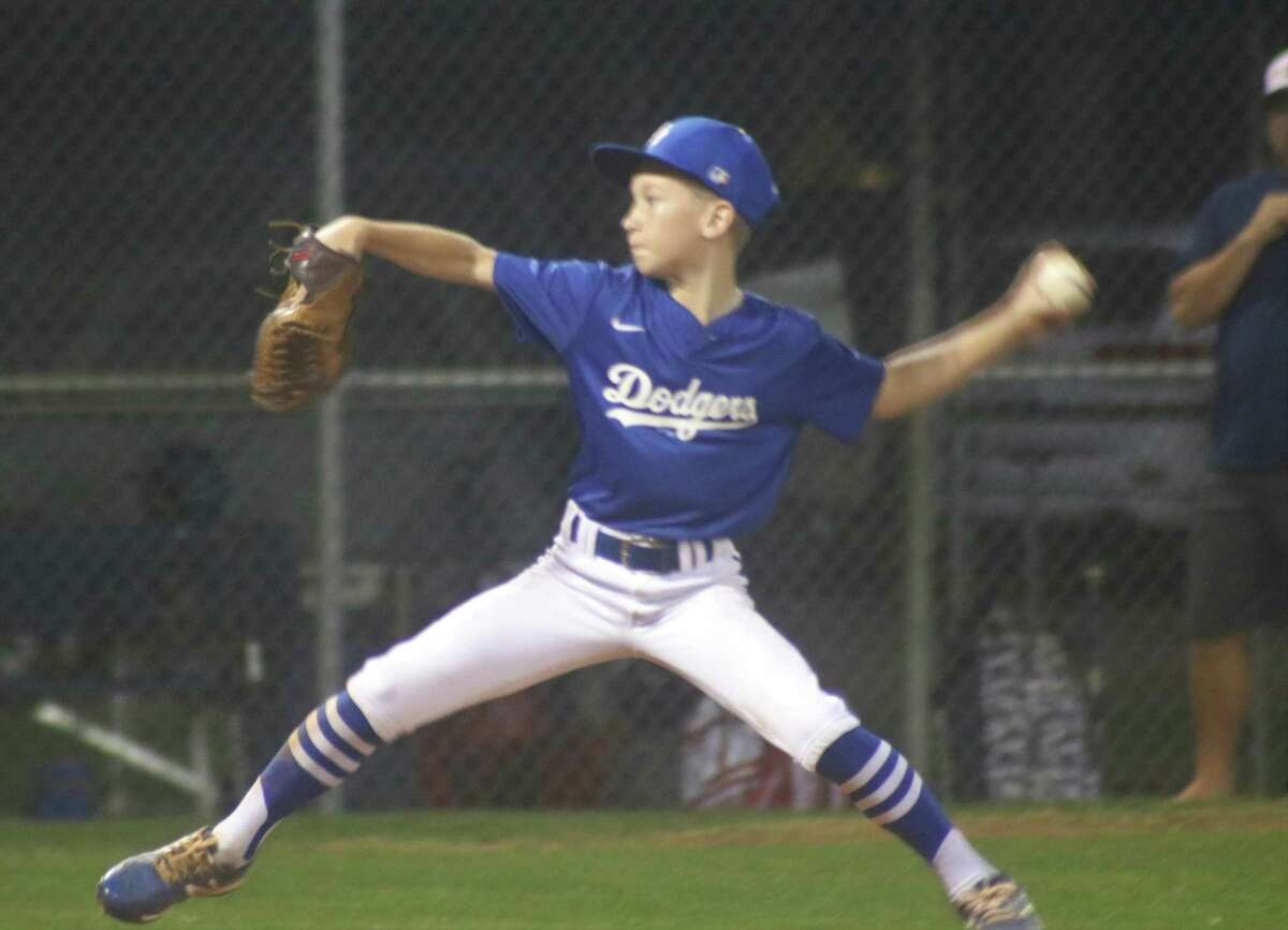 Bayside Area Little League Dodgers pitcher Kross Kilgo demonstrates his form during Tuesday night's win that saw the southpaw strike out seven and walk just one in the city championship tournament game.