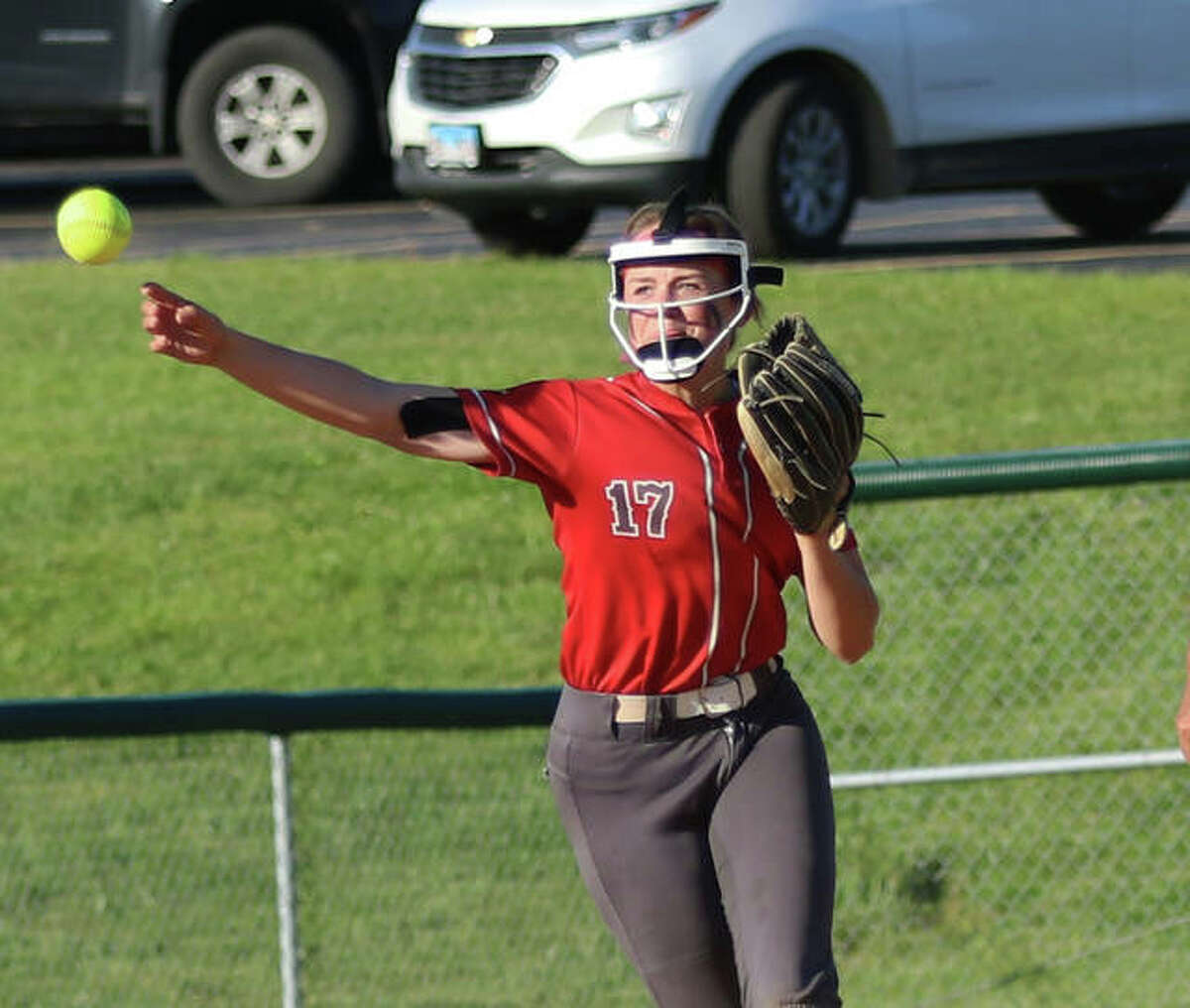 Alton shortstop Alissa Sauls throws to first for an out in a game earlier this month in Godfrey. The Redbirds were in Collinsville on Tuesday and lost a key SWC game to the Kahoks.