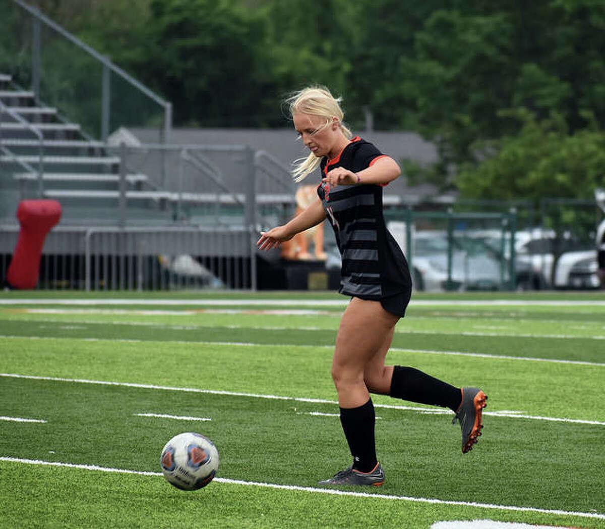 Edwardsville senior Lydia Redmon plays a ball near midfield in the first half against Belleville West.