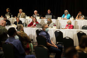 Members of the Michigan Independent Citizens Redistricting Commission listen during a public hearing Wednesday, May 25, 2021 at the Great Hall Banquet and Convention Center in Midland. The event was one of 16 statewide, constitutionally mandated public hearings allowing Michigan residents to share their concerns with the commissioners regarding their redistricting process. (Katy Kildee/kkildee@mdn.net)