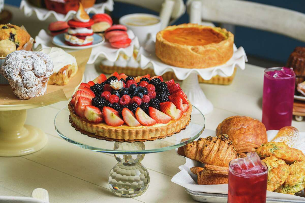 An assortment of hand-crafted baked goods at BouNom Bakery in Avon, including a fruit tart, Parisian flan, croissants and biscuits.