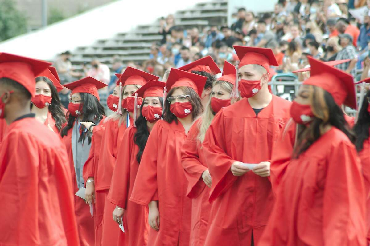 South Houston High School graduates wait to walk across the stage to collect their diplomas during the South Houston High School graduation ceremony at Pasadena ISD Veterans Memorial Stadium for Wednesday.