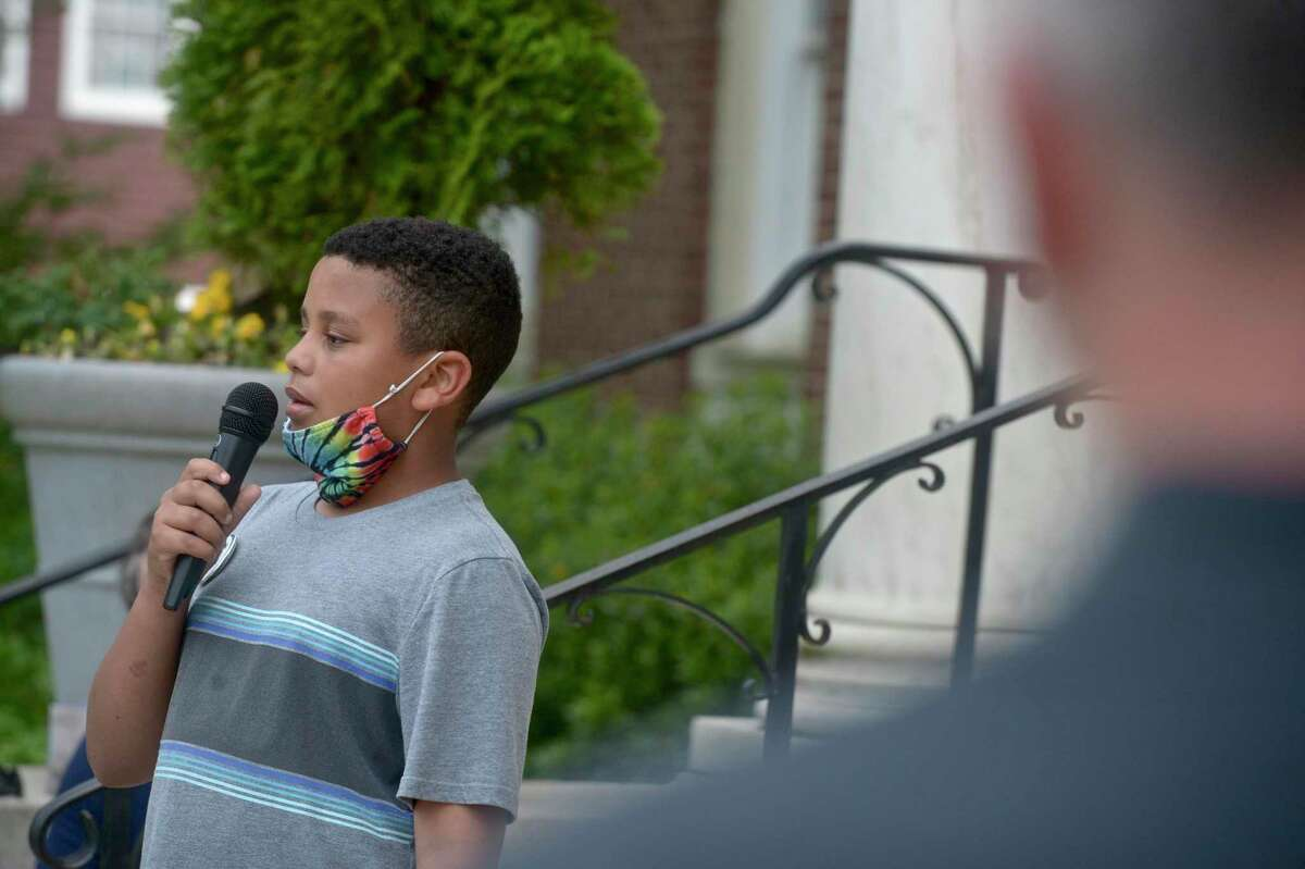 Kenneth Miller, age 10, of Newtown, speaks about an incident directed at him in school at a Newtown Allies for Change peace rally on Tuesday evening, the one year anniversary of George Floyd's slaying in Minnesota. The rally was held in front of the Edmond Town Hall, in Newtown, Conn, May 25, 2021.