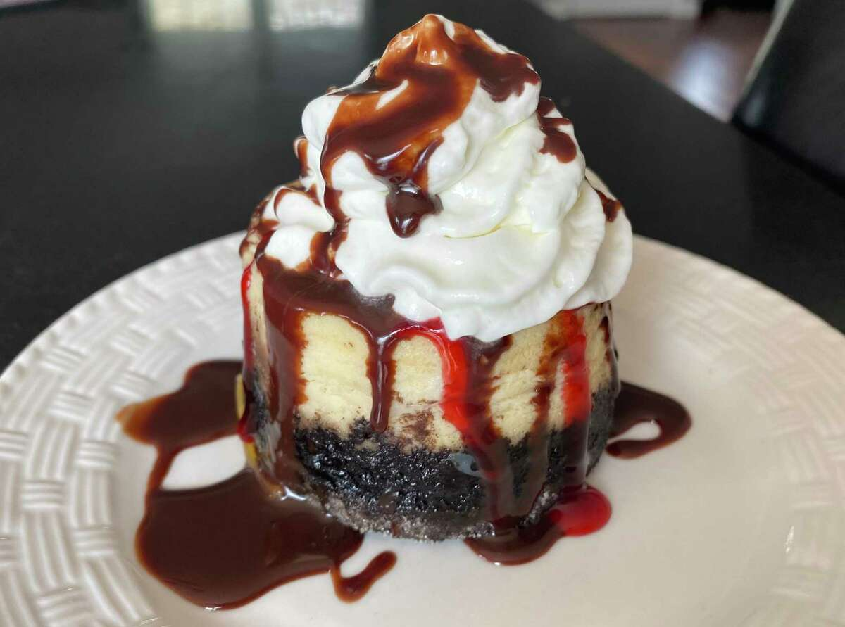 Roberto's mascarpone cheesecake with a chocolate crust and raspberry and Nutella sauces.