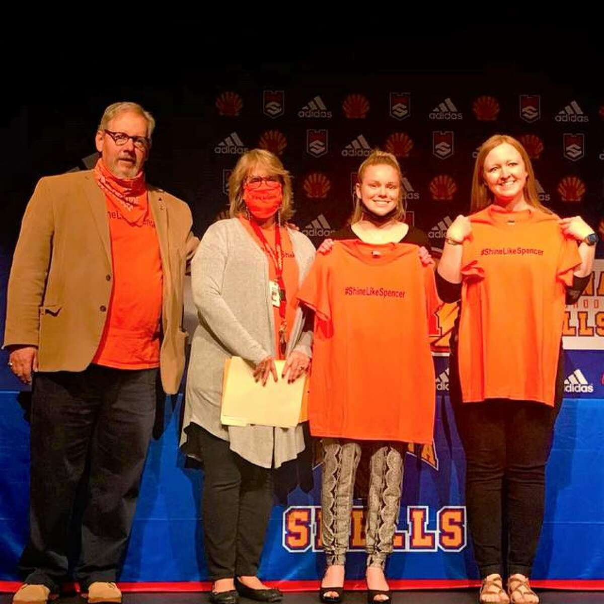 Left to right, Shine Like Spencer Kindness Award creators Mark Bacus and his wife, Debbie Bacus, stand with Roxana High School senior Emma Little and guidance counselor Jen Garrison, at the high school, as Little receives the $500 scholarship in the Bacuses' late son Spencer Bacus' name.