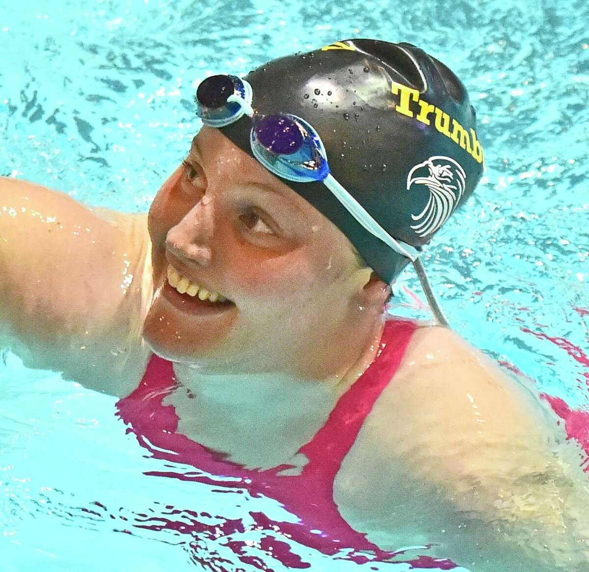 New Haven, Connecticut -Sunday, November 24, 2019: Lauren Walsh of Trumbull H.S. savors victory after winning the fourth heat of the Girls 100 Yard breast stroke during the CIAC State Open Girls Swimming Championship Sunday at Yale University in New Haven.