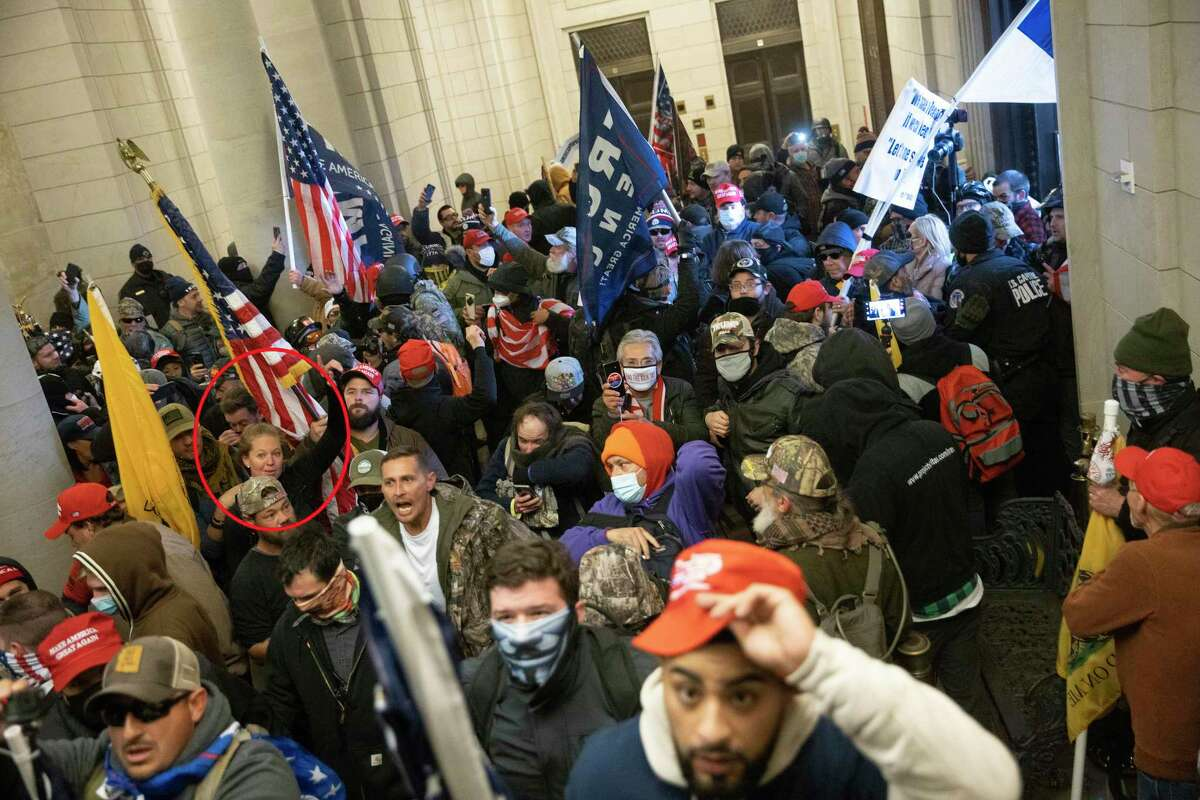 Kerrville resident Elizabeth Rose Williams, 31, left, is among people charging into the Capitol after groups breached security.