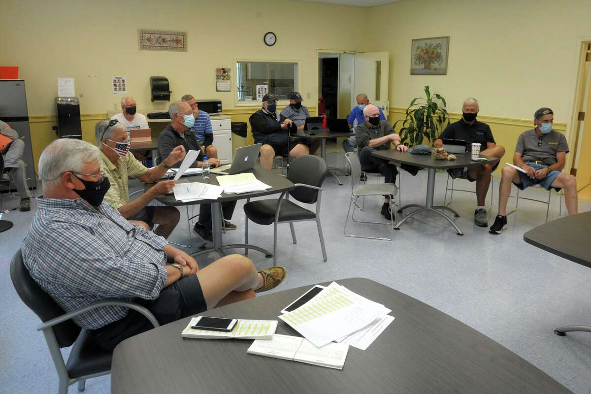 The Trumbull Senior Center men's club hold their first in person meeting in over a year, in Trumbull, Conn. May 25, 2021.