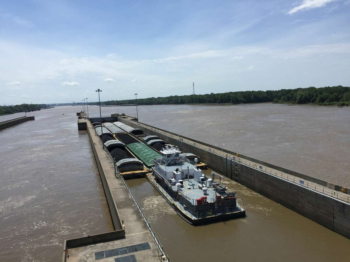 A tow boat leading several barges down the Mississippi River waits to be released from the Melvin Price Locks and Dam.