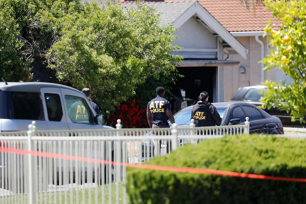 ATF investigators gather at a home, with garage door open, on Angmar Court in San Jose, owned by Samuel Cassidy, suspected of killing eight people and himself at a VTA service yard in San Jose on Wednesday.