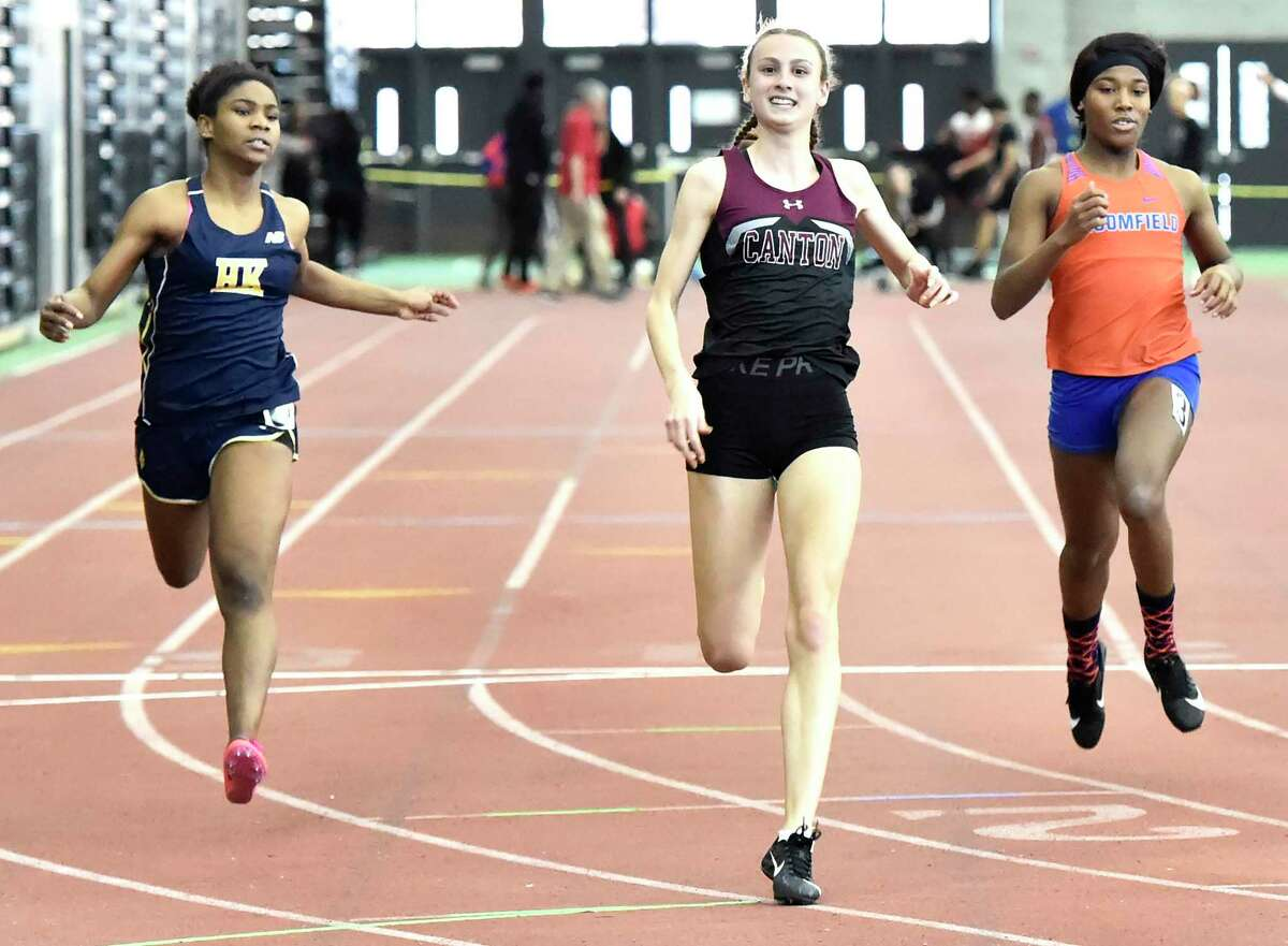 New Haven Connecticut - February 22, 2020: Chelsea Mitchell of Canton H.S., center, wins the girls 55-meter dash defeating second place finisher Kedarjah Lewis of Haddam-Killingworth H.S., left, and third place finisher, transgenderTerry Miller of Bloomfield H.S., right, during the CIAC State Open Indoor Track Championship Saturday at the Floyd Little Athletic Center in New Haven.