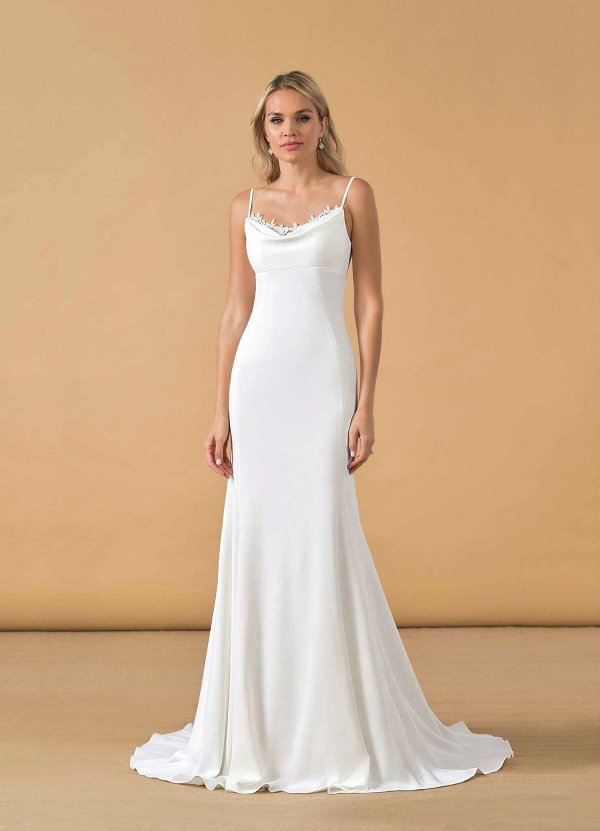 Brides aiming to emulate Ariana Grande's look for their own big day can shop lower-prices similar styles by Azazie for options around $200. TheZarrah dress (pictured here) retails for $169.