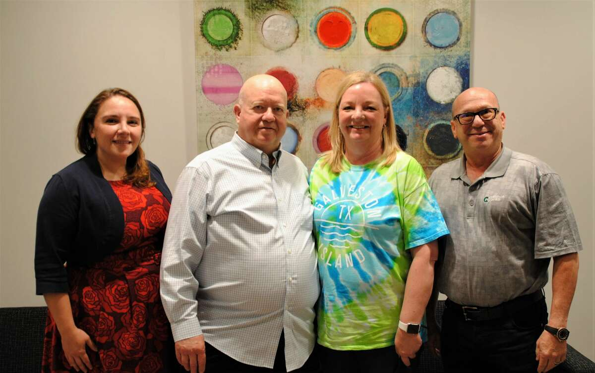 From left are Aimee Bertrand, GHBA CEO; Delbert Rice and Amey Rice, Benefit home buyers and Scott Merovitch, Chesmar city president at the closing of the 2021 GHBA Chesmar Benefit Home on May 21.