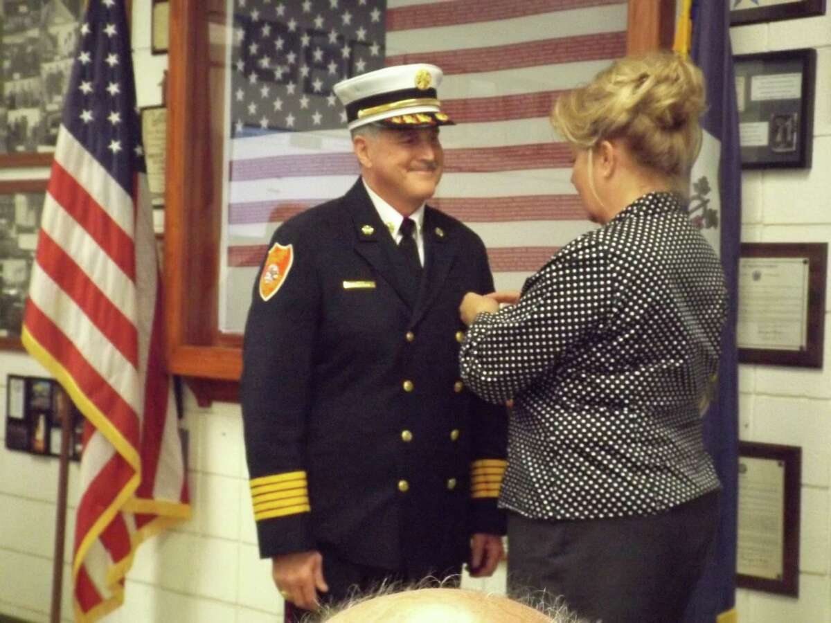 South Fire Chief Michael Howley is pinned by his wife Loretta Howley at his swearing in ceremony in December 2017.