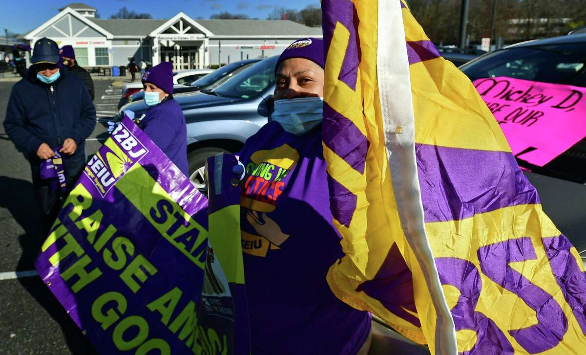 Members of SEIU Local 32BJ join McDonald's franchise workers in November 2020 at an Interstate 95 service plaza in Darien, Conn.