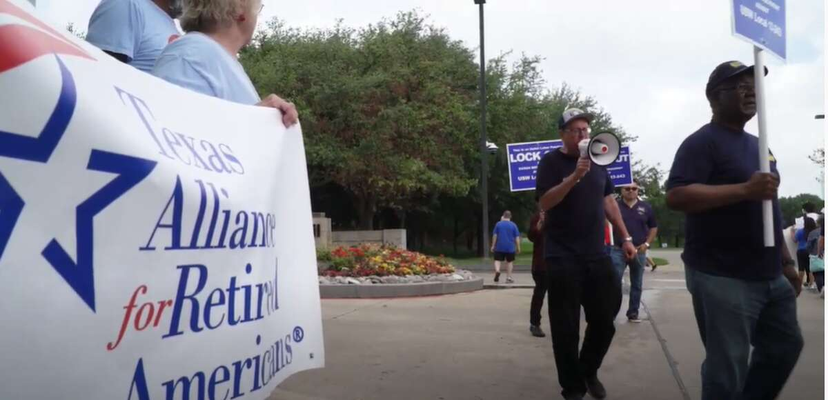 Members of the USW Local 13-243 in Beaumont on Wednesday morning met with other regional and international union member, including from the local representing ExxonMobil's Baytown refinery, outside the company's Irving, Texas headquarters during the company's annual shareholder's meeting.