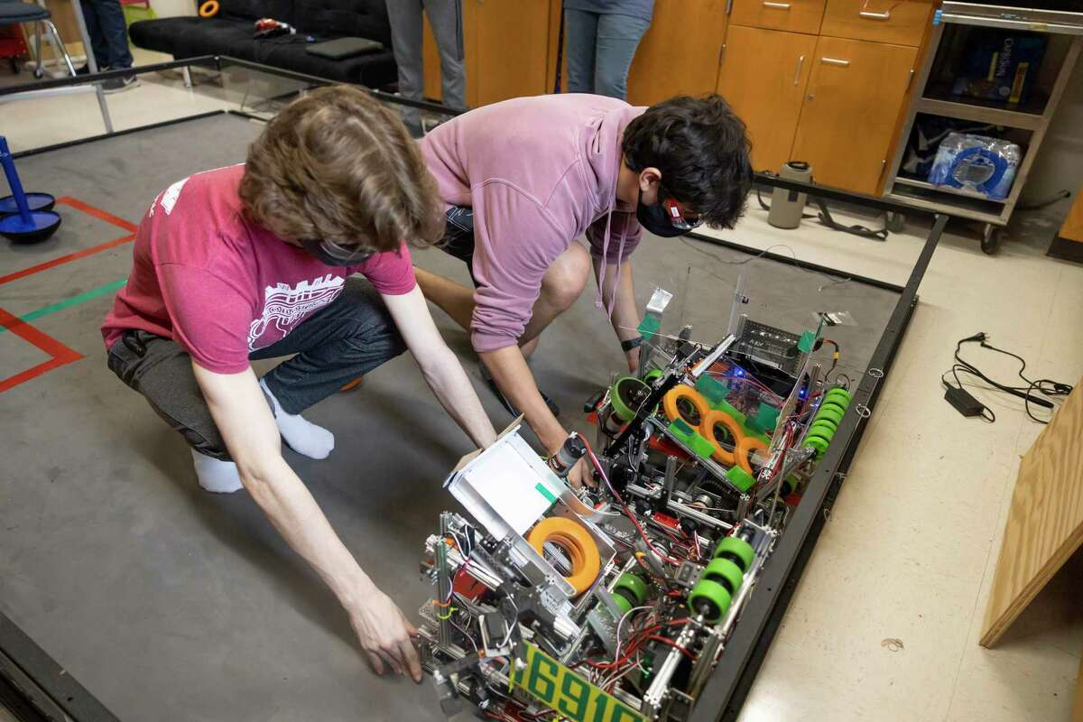 Daniel Vigna, right and Matt Provost prepare their robots during practicce at The Woodlands High School, Wednesday, May 19, 2021, in The Woodlands. The two teams were the only ones to advance in the district to compete in regionals.