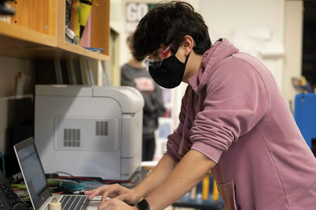 Daniel Vigna codes onto his computer during robotics practice at The Woodlands High School, Wednesday, May 19, 2021, in The Woodlands. The two teams were the only ones to advance in the district to compete in regionals.
