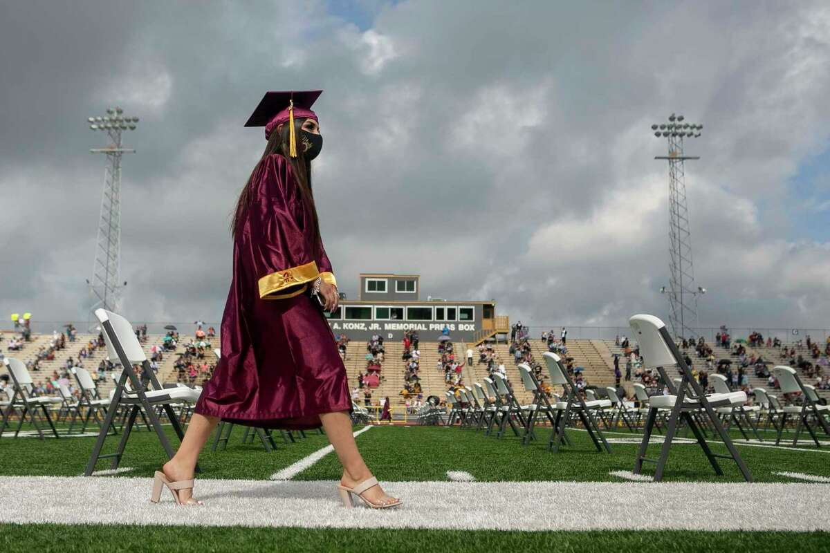 A student graduates last summer. The pandemic has made the school year that much harder, but a new path to graduation eases the pain.