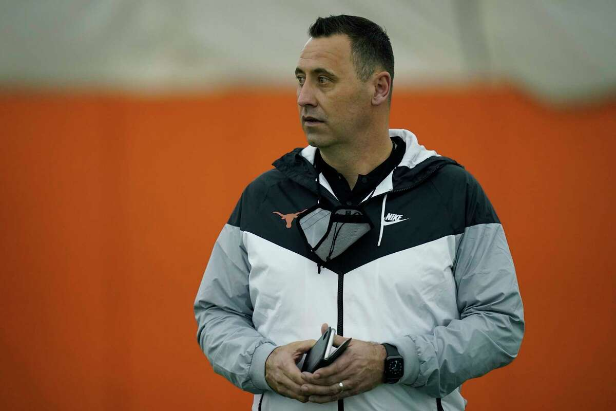 Texas head football coach Steve Sarkisian watches during the school's Pro Day in Austin on March 11, 2021.