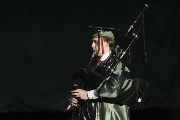 A graduate performs with the pipe band during The Woodlands High School's graduation ceremony at the Cynthia Woods Mitchell Pavilion, Tuesday, May 25, 2021, in The Woodlands. Photo: Gustavo Huerta/Staff Photographer / Houston Chronicle © 2021