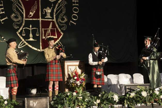 The bag pipe band performs during The Woodlands High School's graduation ceremony at the Cynthia Woods Mitchell Pavilion, Tuesday, May 25, 2021, in The Woodlands. Photo: Gustavo Huerta/Staff Photographer / Houston Chronicle © 2021