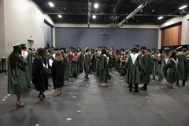 Hundreds of graduates lineup before The Woodlands High School's graduation ceremony at the Cynthia Woods Mitchell Pavilion, Tuesday, May 25, 2021, in The Woodlands. Photo: Gustavo Huerta/Staff Photographer / Houston Chronicle © 2021
