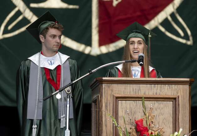Student body class president Elizabeth Billig, right, offers a welcome and introduction to graduates and family alongside Max van Otterdyk, during The Woodlands High School's graduation ceremony at the Cynthia Woods Mitchell Pavilion, Tuesday, May 25, 2021, in The Woodlands. Photo: Gustavo Huerta/Staff Photographer / Houston Chronicle © 2021