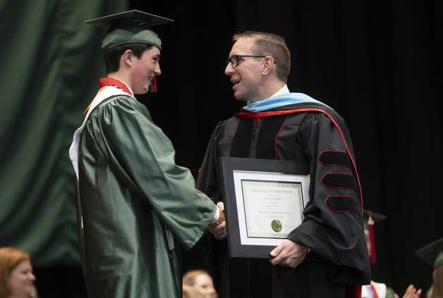 Conroe ISD Superintendent Curtis Null, right, shares a laugh with Class valedictorian Jack Andrew Northcott during The Woodlands High School's graduation ceremony at the Cynthia Woods Mitchell Pavilion, Tuesday, May 25, 2021, in The Woodlands. Photo: Gustavo Huerta/Staff Photographer / Houston Chronicle © 2021