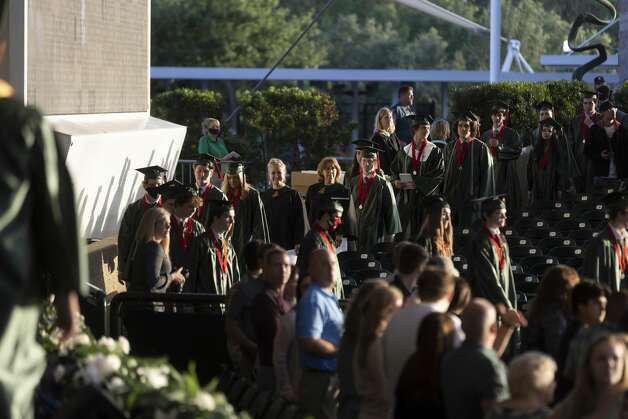 Graduates find their seating during The Woodlands High School's graduation ceremony at the Cynthia Woods Mitchell Pavilion, Tuesday, May 25, 2021, in The Woodlands. Photo: Gustavo Huerta/Staff Photographer / Houston Chronicle © 2021
