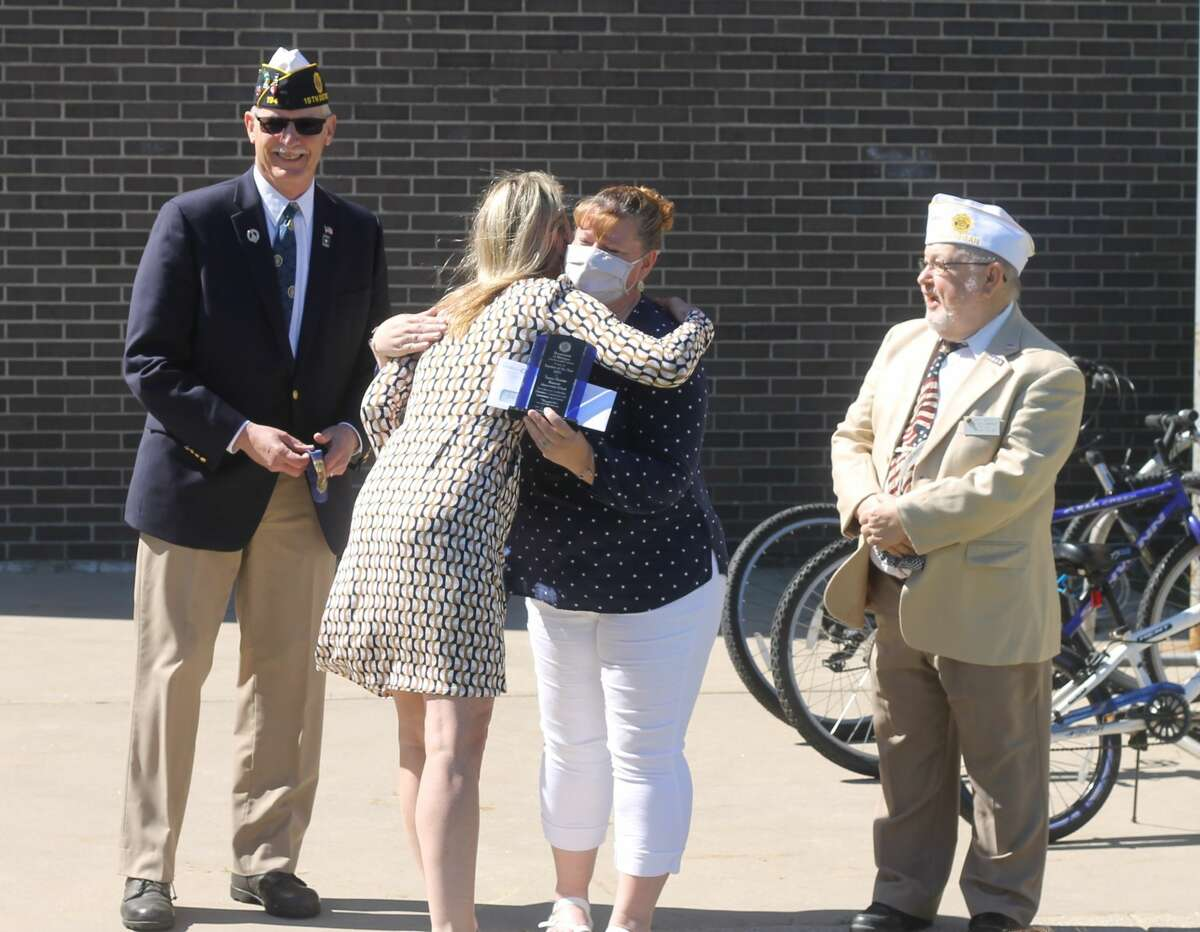 Kennedy Elementary principal Joanie Wiersma congratulates fifth-grade teacher Tanya Hunter for earning the Zone 4 Teacher of the Year Award from the American Legion Education and Scholarship Committee on Wednesday.