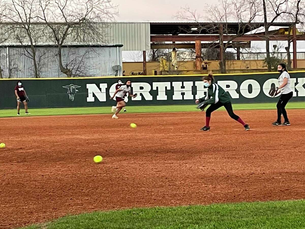 The Northbrook softball team practices pre-season on the afternoon of Jan. 29. Northbrook's Jamie Henk was named the District 17-6A Coach of the Year.