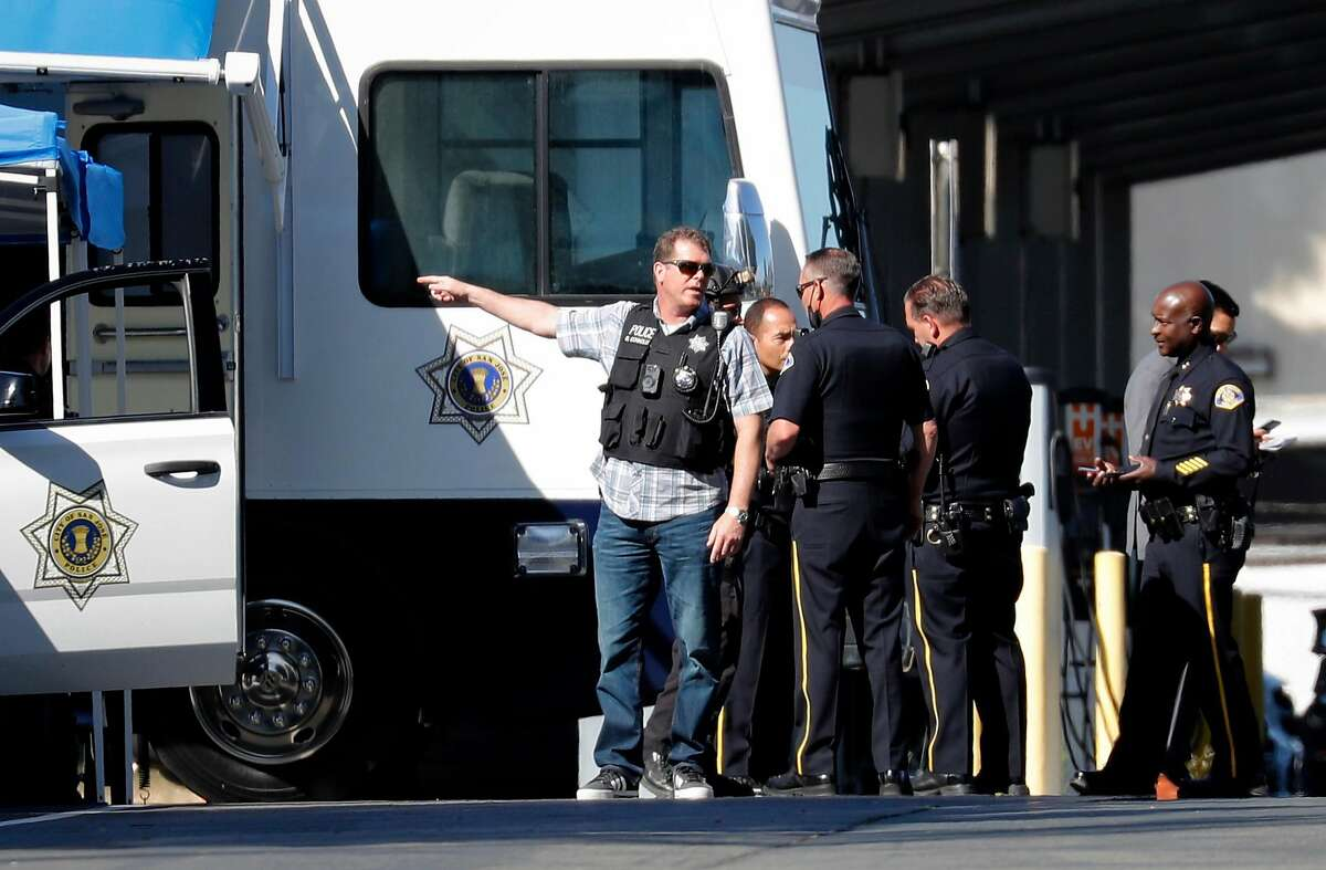Police officers congregate at a command post near the First Street VTA service yard where a mass shooting took place Wednesday, May 26, 2021, in San Jose, Calif.