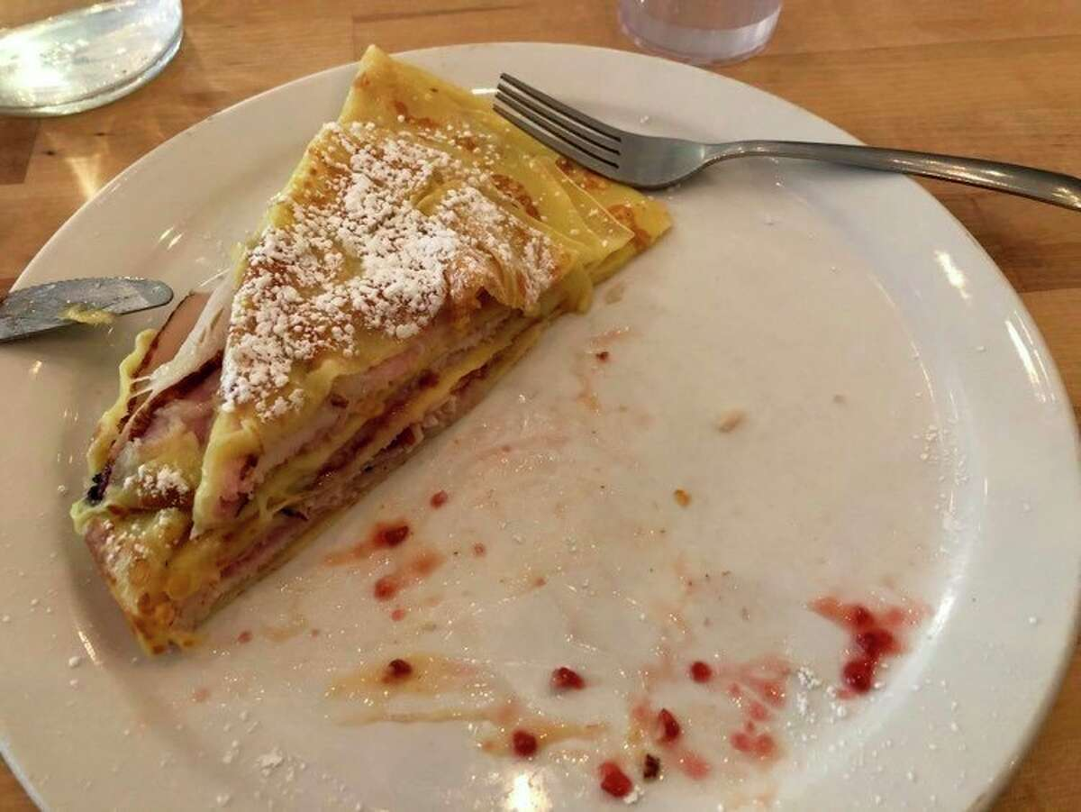 The Edmond Dantes crepe consists of ham, turkey, swiss cheese, raspberry preserves and honey mustard, all wrapped in a paper-thin crepe and dusted with powdered sugar. (Victoria Ritter/vritter@mdn.net)
