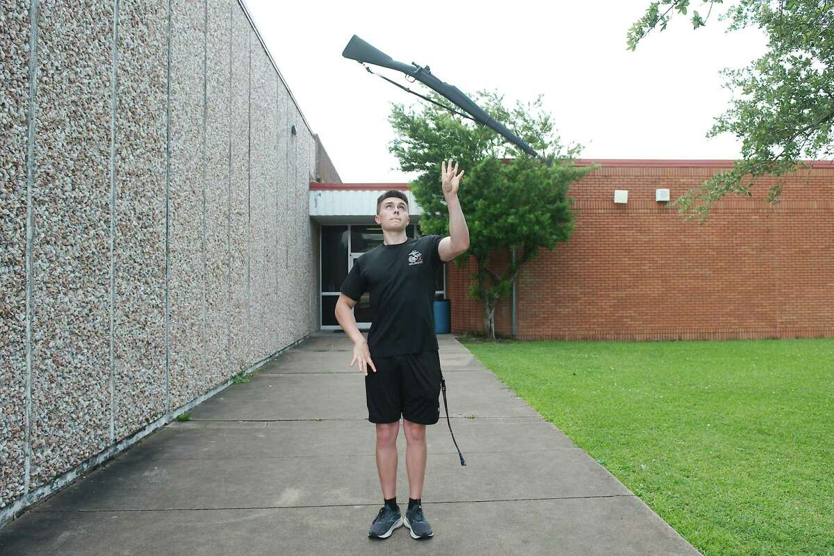 Alvin High School graduating senior Trenton Parker demonstrates his skills he developed practicing for drill competitions. Trenton will attend the U.S. Naval Academy in the fall.