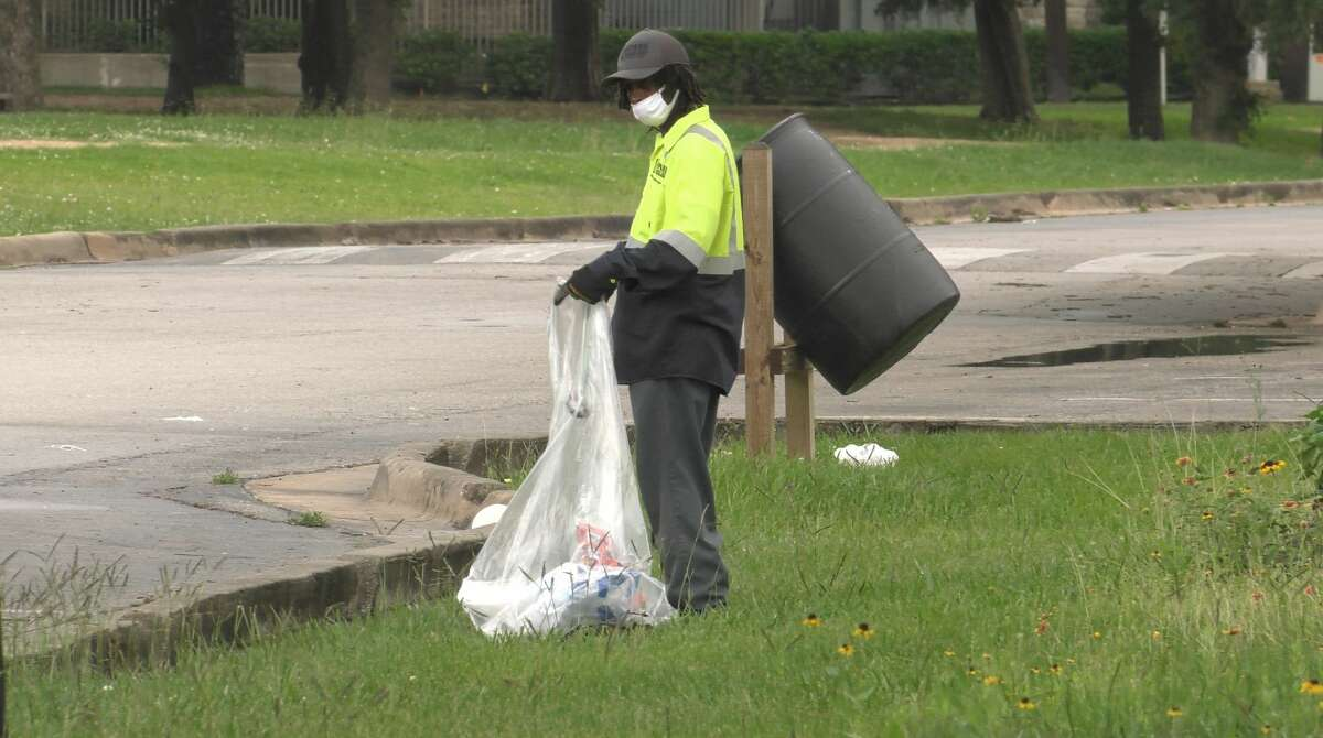 Crews pick up litter in MacGregor Park on Monday, May 24, 2021.