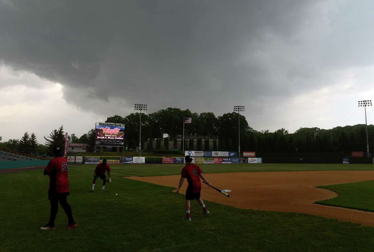 Tri-City ValleyCats players practice on the field as a strong storm moves in during a media day event on Wednesday, May 26, 2021, at Joseph L. Bruno Stadium in Troy, N.Y. (Will Waldron/Times Union)