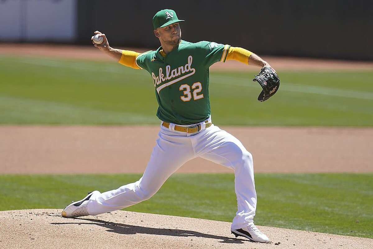 Oakland Athletics' James Kaprielian pitches against the Seattle Mariners during the first inning of a baseball game in Oakland, Calif., Wednesday, May 26, 2021. (AP Photo/Jeff Chiu)