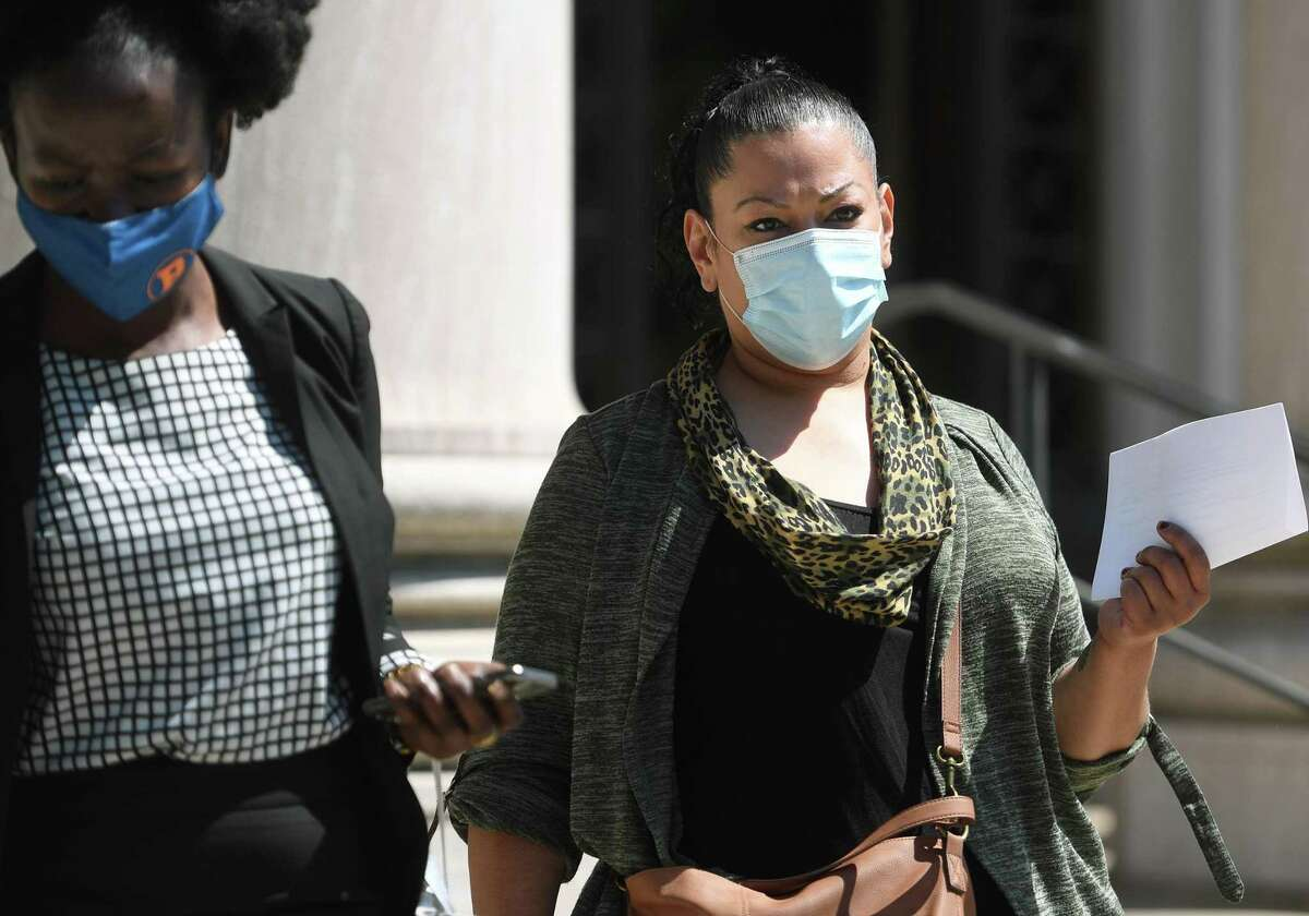 Bridgeport Board of Education member Jessica Martinez exits her arraignment in federal court in New Haven, Conn. on Tuesday, May 25, 2021.