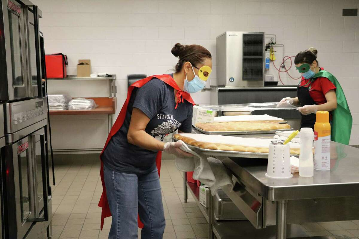 Katy Independent School District is preparing to serve free curbside grab-and-go and hot meals to area students this summer. Here, a school lunch worker at Stephens Elementary in Katy wears a superhero cape and mask as she prepares to serve lunch to students on National School Lunch Hero Day on Friday, May 7.
