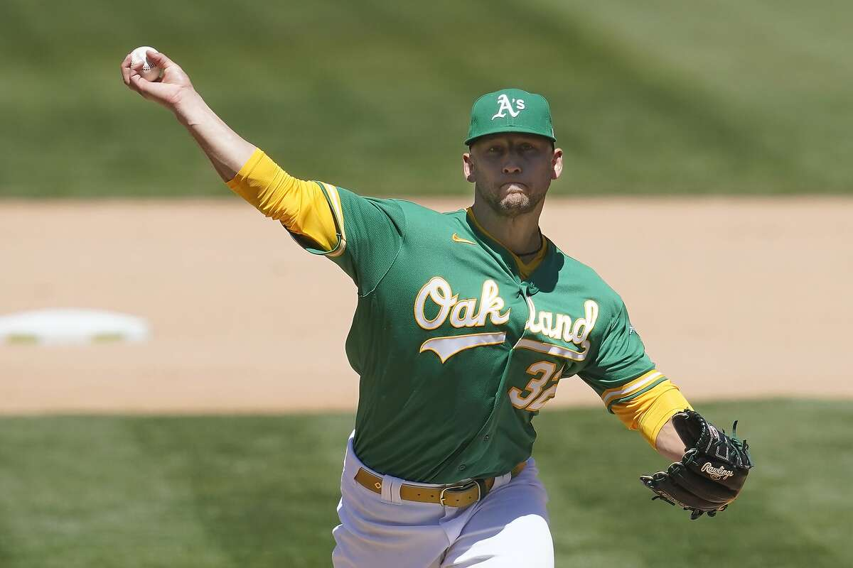 Oakland Athletics' James Kaprielian pitches against the Seattle Mariners during the seventh inning of a baseball game in Oakland, Calif., Wednesday, May 26, 2021. (AP Photo/Jeff Chiu)