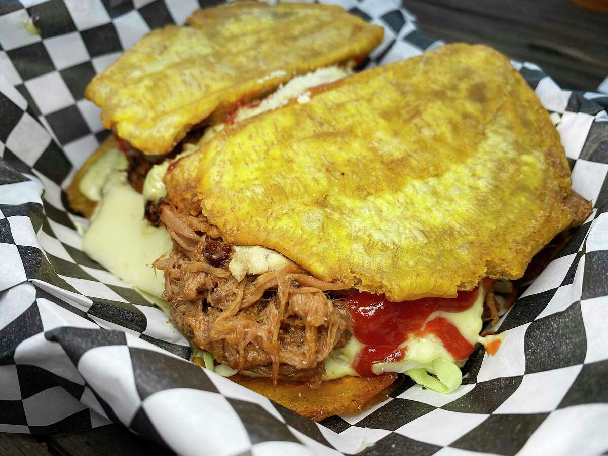 A patacón is a Venezuelan sandwich with fried plantains in place of the bread at Zulia's Kitchen, a Venezuelan food truck at The Block SA food truck park. This patacón is filled with shredded beef brisket, ham, coleslaw and cheese.